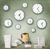 Businessman drowning in paperwork. Clocks on wall Stock Image