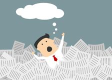 Businessman drowning in a sea of paperwork Royalty Free Stock Photo