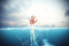 Businessman drowns and asks for help. Businessman drowning in the sea and asks for help Royalty Free Stock Photography