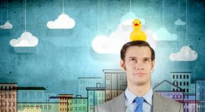 Businessman with duck Stock Images