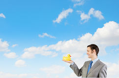 Businessman with duck. Funny businessman with yellow rubber duck toy Royalty Free Stock Images