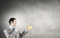 Businessman with duck Stock Photography