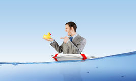 Businessman with duck Stock Photos