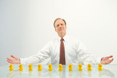 Businessman with ducks Stock Photography
