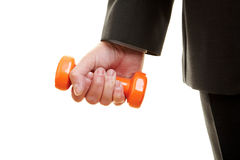 Businessman with a dumbbell. A hand lifting a small orange dumbbell Stock Photography