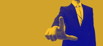 Businessman in duotone. Businessman in a yellow and blue duotone stock photo
