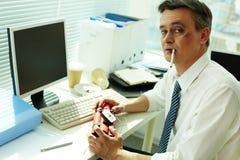 Businessman with dynamite Stock Photo