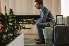 Businessman eagerly waiting for this flight Royalty Free Stock Photos