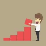 A businessman earn more, the graph increases Stock Photos
