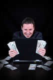 Businessman is earned the money. On the black background Stock Photo