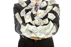 Businessman earns us dollar with money rain. With white background Royalty Free Stock Photo