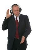 Businessman in earphones Stock Image