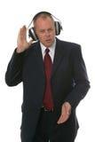 Businessman in earphones stock image