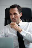 Businessman with earphones and laptop computer Royalty Free Stock Photos