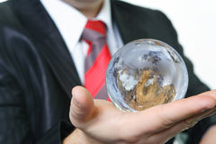 The businessman and the earth. The businessman has control over globe in environment protection Stock Photo