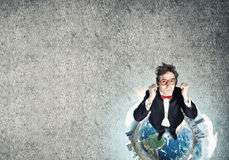 Businessman on Earth globe Stock Images