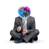 Businessman with Earth instead head and gold lamp Royalty Free Stock Photos