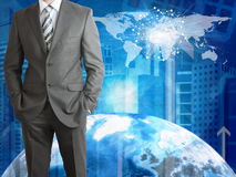 Businessman with Earth, skyscrapers and world map Royalty Free Stock Images