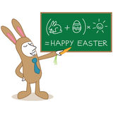 Businessman easter bunny costume board funny calculation Royalty Free Stock Photography