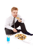 Businessman eat pizza Royalty Free Stock Images