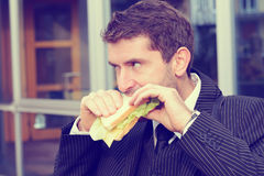 Businessman is eating bread Stock Photo