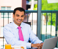 Businessman eating breakfast Stock Images