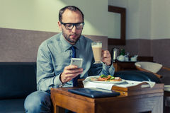 Businessman eating breakfast at home/hotel. Indoor photo. Businessman eating breakfast at home/hotel. Indoor photo Royalty Free Stock Photos