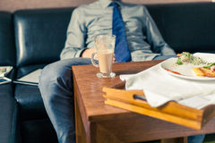 Businessman eating breakfast at home/hotel. Indoor photo. Royalty Free Stock Photography