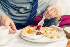Businessman eating breakfast at home/hotel. Indoor photo. Businessman eating breakfast at home/hotel. Indoor photo Royalty Free Stock Image