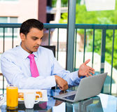 Businessman eating breakfast and working Royalty Free Stock Photo