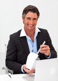 Businessman eating chinese food Stock Photo