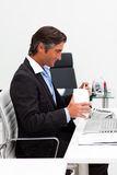 Businessman eating chinese food with chopstick Stock Photos
