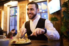 Businessman Eating Food n Restaurant stock image