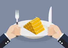 Businessman eating gold ingots Royalty Free Stock Photos