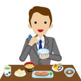 Businessman eating Japanese breakfast Stock Photo