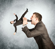 Businessman eating little man Stock Image