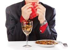 Businessman eating money Stock Photography