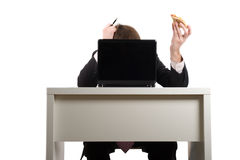 Businessman eating pizza, Stock Photo