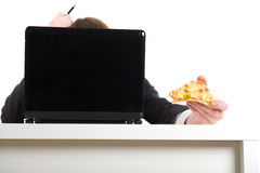 Businessman eating pizza, Stock Image