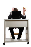 Businessman eating pizza Stock Image