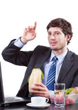 Businessman eating and raises his hand Royalty Free Stock Image