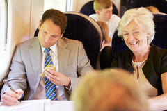 Businessman Eating Sandwich On Train Journey Royalty Free Stock Photography