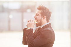 Businessman eating on to go Royalty Free Stock Photo