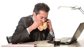 Businessman eating unhealthy food stock video footage