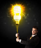 Businessman with an eco-friendly bulb Stock Photo