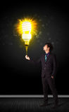 Businessman with an eco-friendly bulb Stock Photography