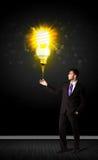 Businessman with an eco-friendly bulb Stock Photos
