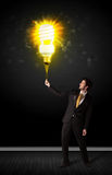 Businessman with an eco-friendly bulb Stock Photos