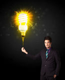 Businessman with an eco-friendly bulb Royalty Free Stock Photo