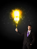 Businessman with an eco-friendly bulb Stock Images